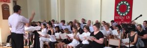 Paul Carrr directing 3 Shires Choir at St Hilda's Warley